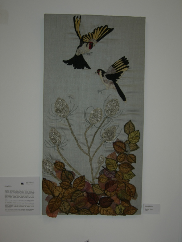"""embroidered birds and leaves"""